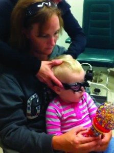Figure 1. One example of a young child wearing the Interacoustics EyeSeeCam goggle for vHIT testing.